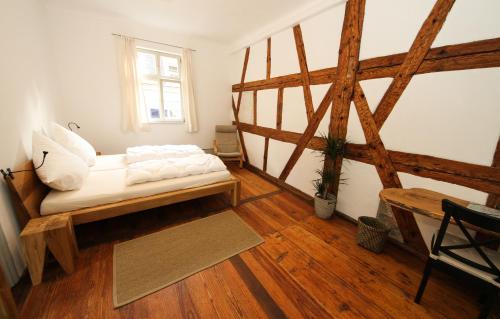 Ein Bett oder Betten in einem Zimmer der Unterkunft Altstadtpalais im Sand
