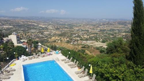 A view of the pool at Pissouriana Apartments or nearby