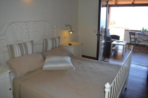 A bed or beds in a room at Villa Russo