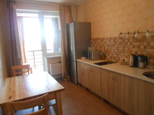 A kitchen or kitchenette at Apartments on Ostrovskogo 20A