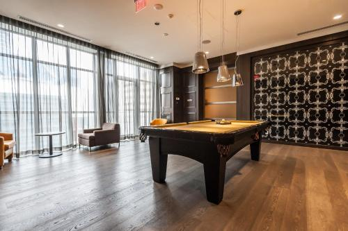 A pool table at Loft - Entertainment & Financial District