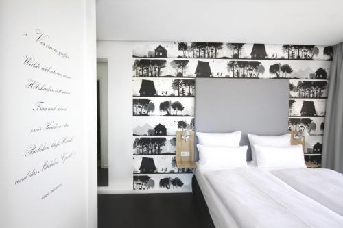 Un ou plusieurs lits dans un hébergement de l'établissement Grimm's Potsdamer Platz