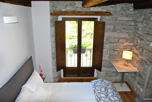 Letto o letti in una camera di Il Borgo Antico