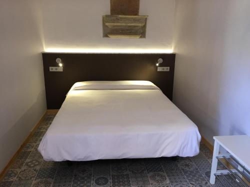 Cama ou camas em um quarto em BCN Home Guest House
