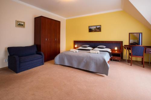 A bed or beds in a room at Penzión Ingrid