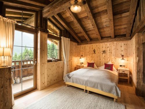 Ein Bett oder Betten in einem Zimmer der Unterkunft Gletscher-Chalet Stubai