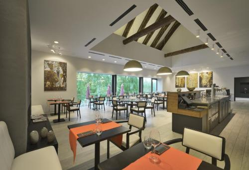 A restaurant or other place to eat at Yard Resort
