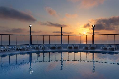 The swimming pool at or near Isrotel Tower Hotel