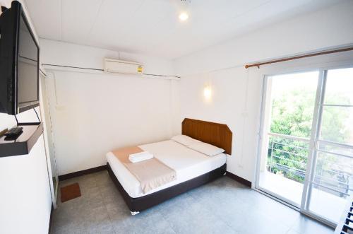 Ein Bett oder Betten in einem Zimmer der Unterkunft House No.11