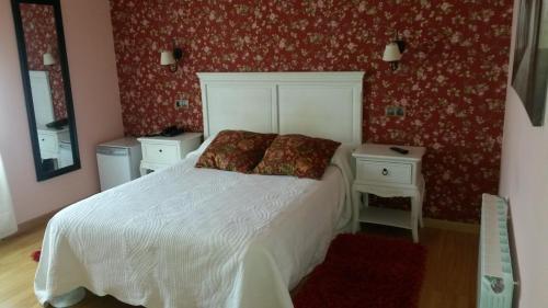 Cama o camas de una habitación en Hotel Casa Fernando II