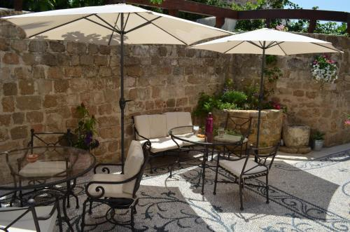A patio or other outdoor area at Hotel Ellique
