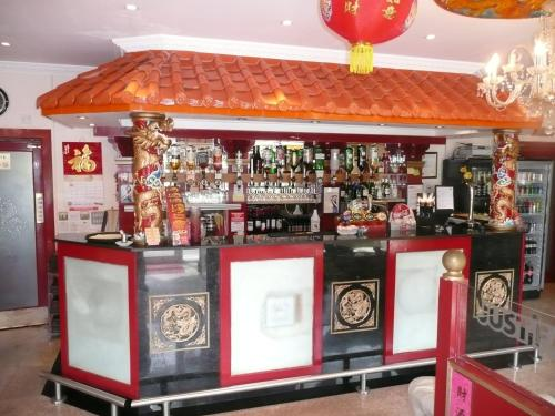 The lounge or bar area at Beijing Dragon Hotel