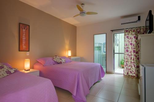 Cama ou camas em um quarto em Pousada Novo Prado