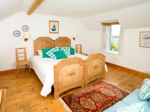 A bed or beds in a room at Craigadam
