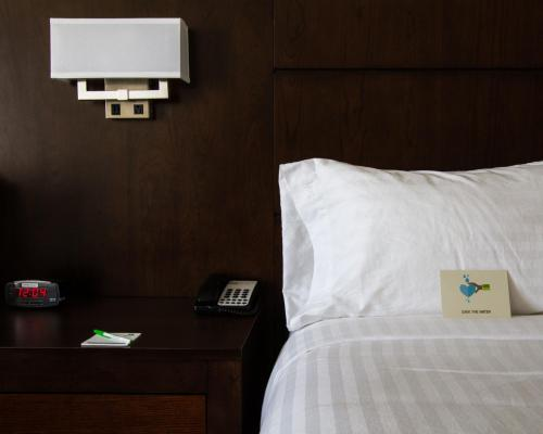 A bed or beds in a room at Holiday Inn Victorville, an IHG Hotel