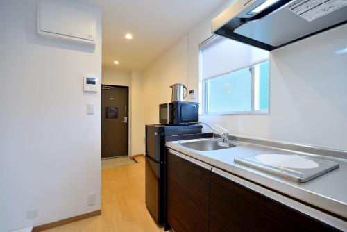 A kitchen or kitchenette at Hotel Hakone Terrace Annex