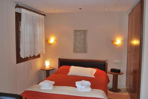 Ένα ή περισσότερα κρεβάτια σε δωμάτιο στο Guesthouse Kallisti