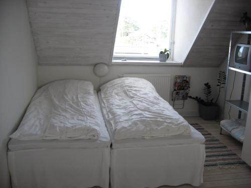 En eller flere senge i et værelse på B&B Korsørvej