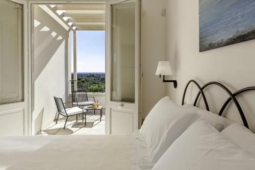 A bed or beds in a room at Tenuta Monticelli