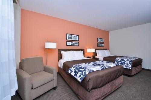 Rúm í herbergi á Sleep Inn & Suites Austin – Tech Center