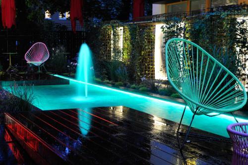Der Swimmingpool an oder in der Nähe von Nala Individuellhotel