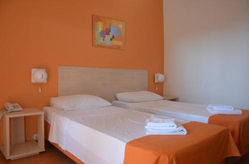 A bed or beds in a room at Hotel Borik