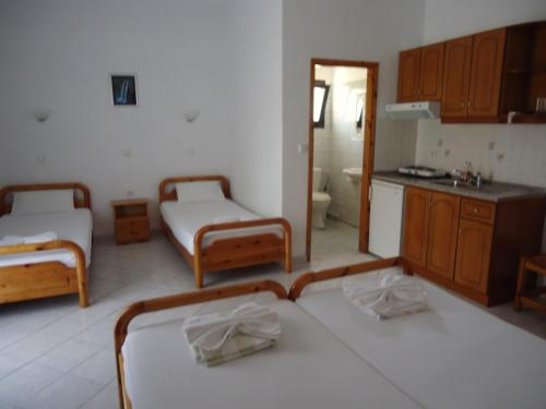 Cama o camas de una habitación en Panorama Hotel
