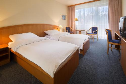 A bed or beds in a room at OREA Hotel Voronez II Brno
