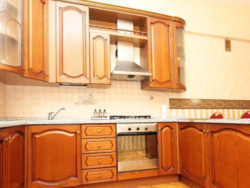 A kitchen or kitchenette at ApartLux na Ploshadi Pobedy