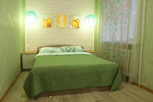 Кровать или кровати в номере Apartment Fadeeva 28/2