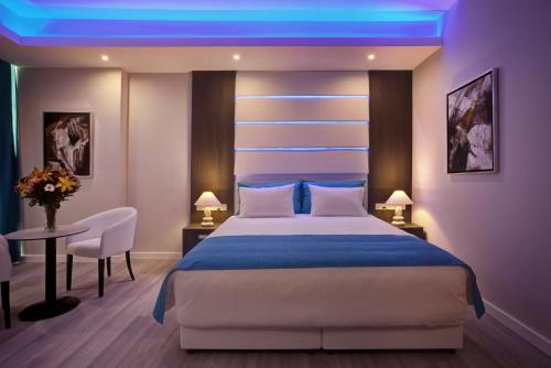 A bed or beds in a room at The Josephine Boutique Hotel