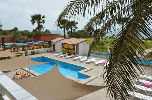 The swimming pool at or near Ocean Villa Heights