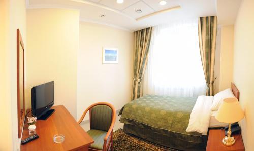 Кровать или кровати в номере Отель Малетон - Гарибальди