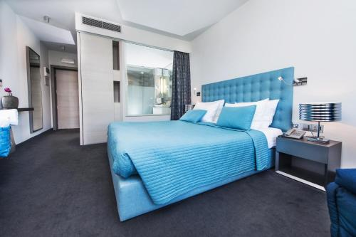 A bed or beds in a room at Hotel Arupinum