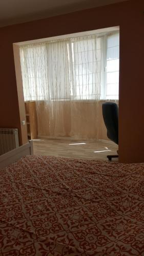 Телевизор и/или развлекательный центр в Апартаменты на Клубничной