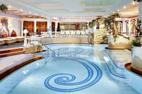 The swimming pool at or near Hotel Neue Post