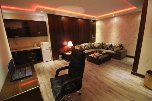 Uma área de estar em Shagan Aparthotel