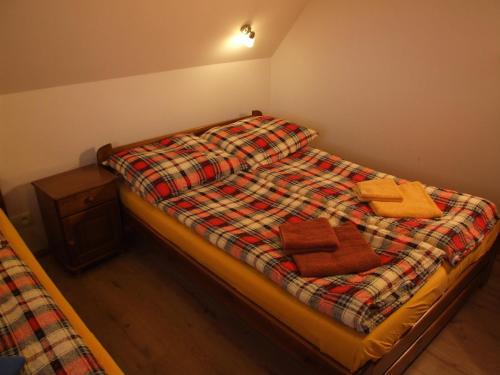 Łóżko lub łóżka w pokoju w obiekcie Banskie Zacisze