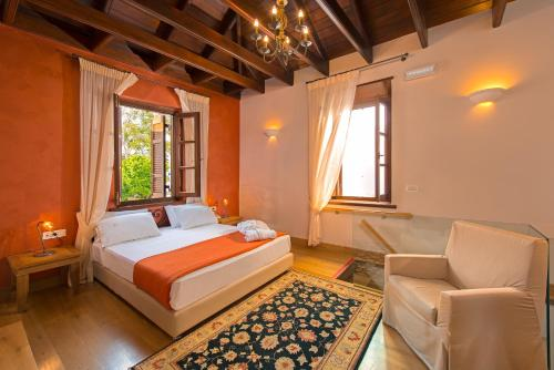 A bed or beds in a room at Rodos Niohori Elite Suites Boutique Hotel