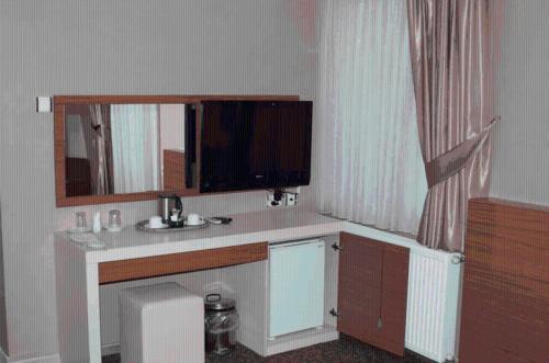 TV/Unterhaltungsangebot in der Unterkunft Tac Hotel