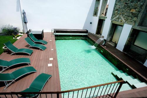 A piscina em ou perto de Casa Dos Poços