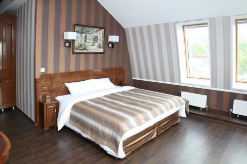 Кровать или кровати в номере Бутик-Отель Абсолют
