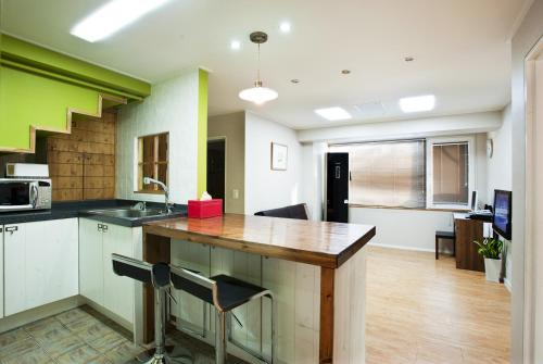 A kitchen or kitchenette at Myeongdong Ecohouse
