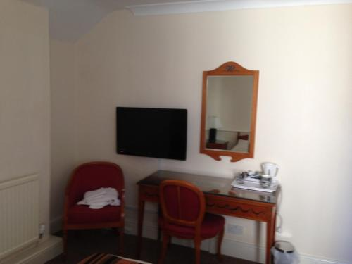 A television and/or entertainment center at Victoria hotel