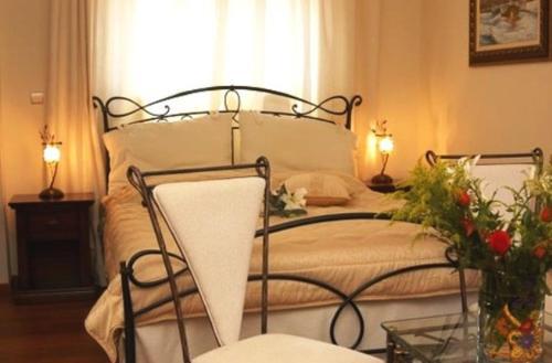 Ένα ή περισσότερα κρεβάτια σε δωμάτιο στο Ξενοδοχείο Αιγαίο
