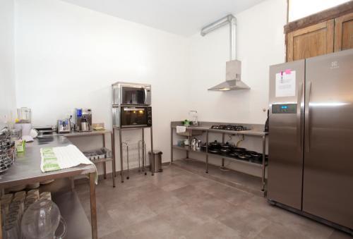 A kitchen or kitchenette at Arche Noah Boutique Hostel