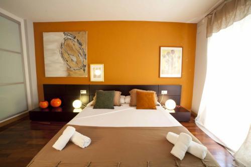 A bed or beds in a room at Apartamentos Kasa25 Navas