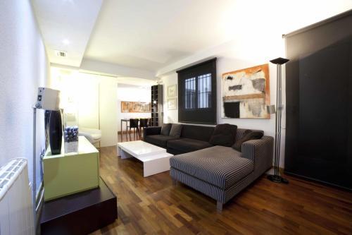 A seating area at Apartamentos Kasa25 Navas