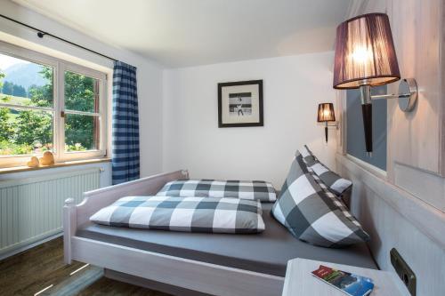 A bed or beds in a room at Der Landhof