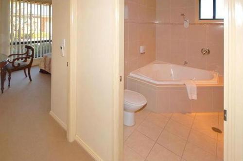 A bathroom at Potters Apartments